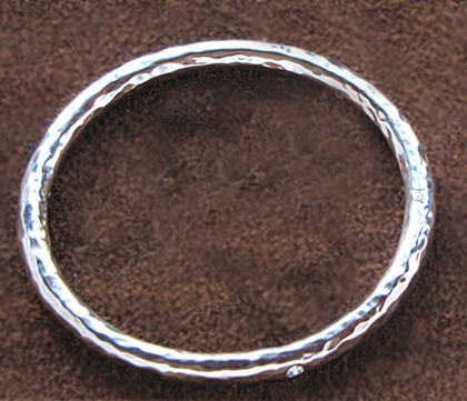 hand forged sterling silver bangle with diamonds.