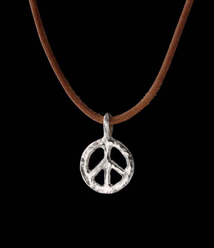 small sterling silver peace sign on tan rawhide