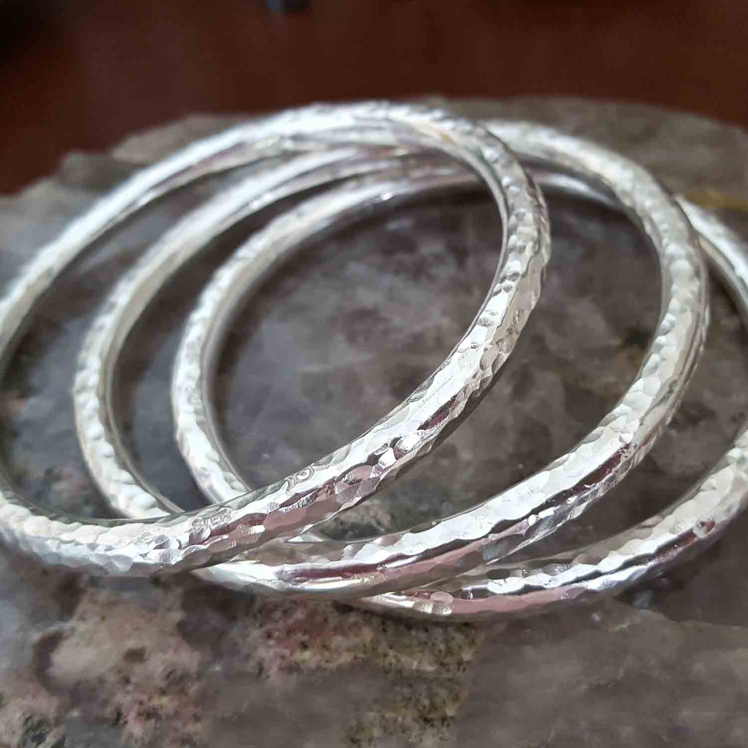 metalsmith jewelry custom reilly sterling silver bangles forged hand heather